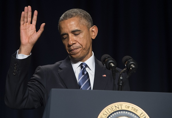 President Barack Obama waves after speaking during the National Prayer Breakfast in Washington, DC, February 5, 2015. (PHOTO: SAUL LOEB/AFP/Getty Images)
