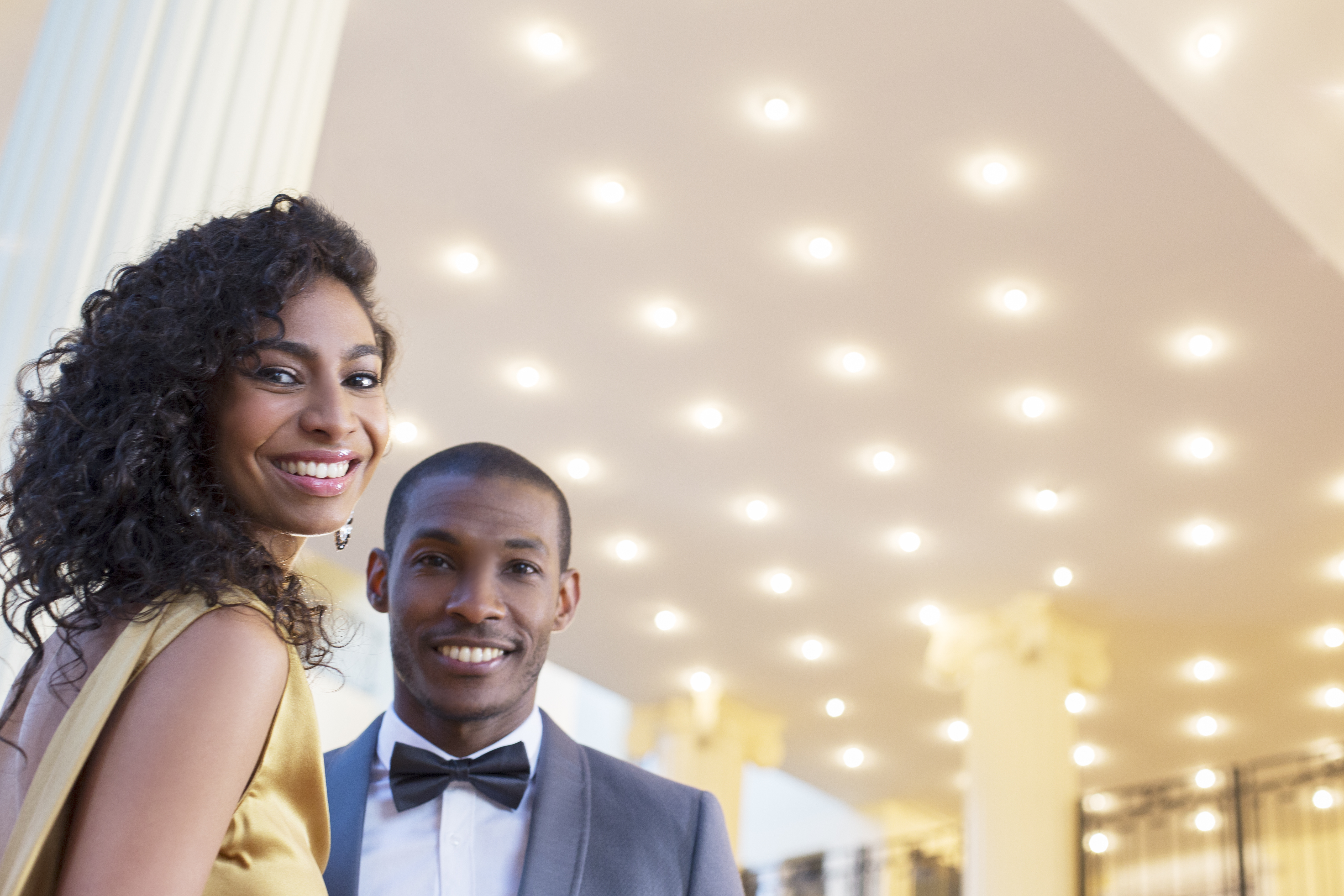 Portrait of well dressed smiling couple