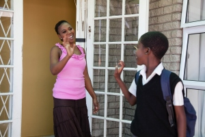 Young African Boy leaving for school, Cape Town, South Africa