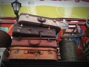 Low Angle View Of Abandoned Suitcases On Shelf At Home