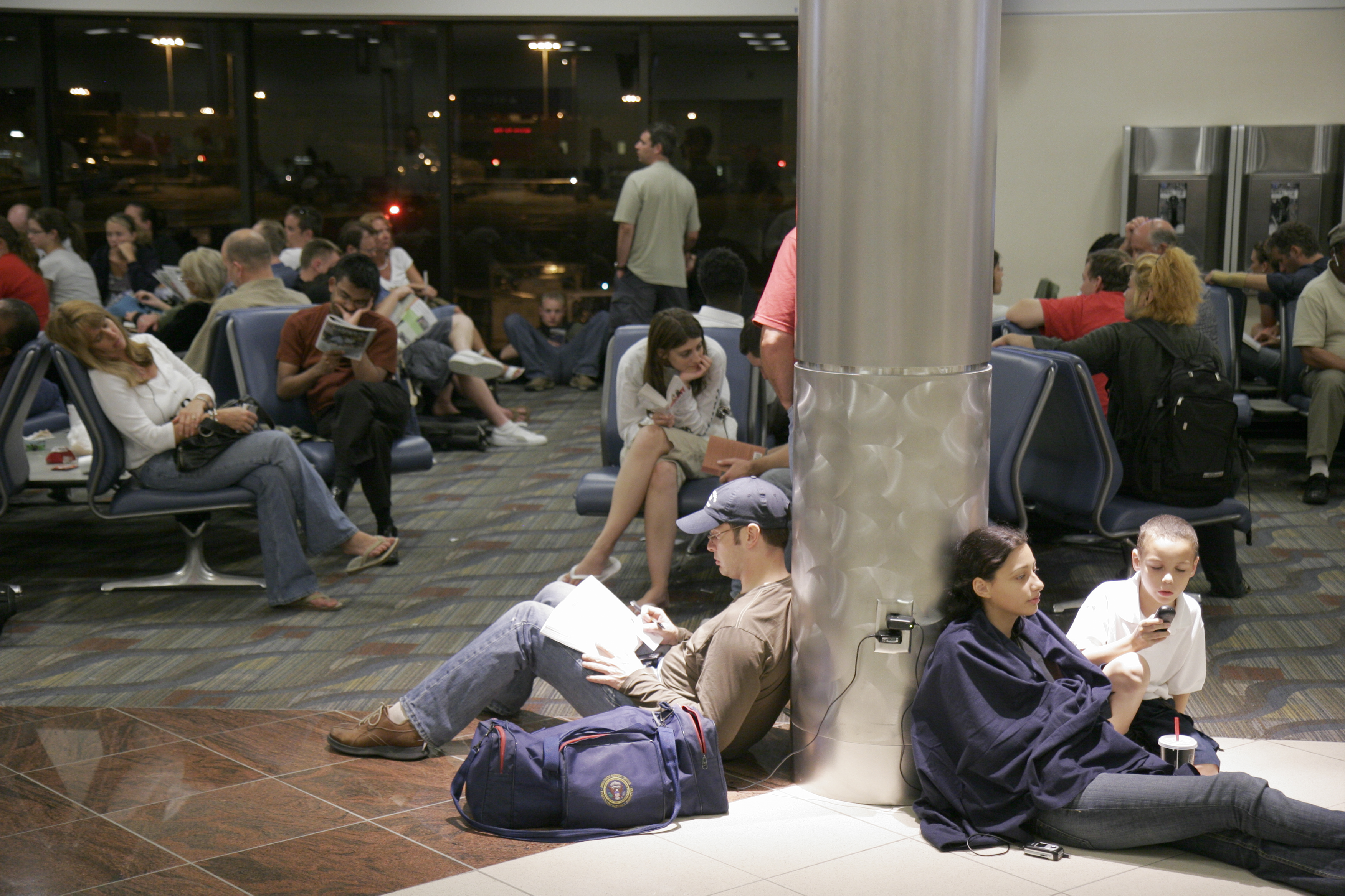 Passengers waiting for a delayed Delta Airlines flight at Hartsfield-Jackson Atlanta International Airport.